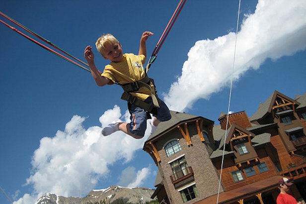 The Giant Swing in the Mountain Village Plaza at Big Sky can launch little ones some 30 feet into the air.   - © Big Sky Resort