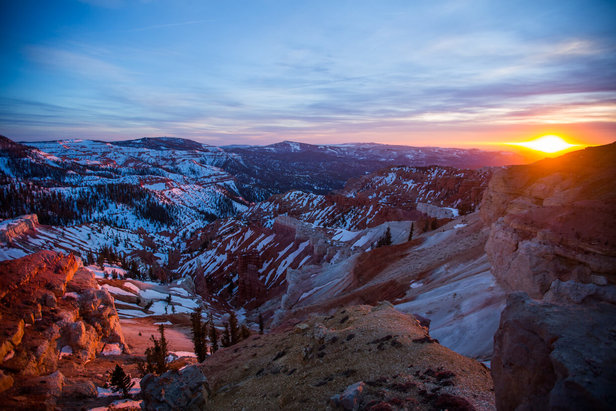 At Brian Head, iron oxides found in the rocks produce red, orange, and yellow colors that stand out from the blanket of white snow that's nearly everywhere else.  - © Adam Clark